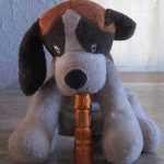 toy dog holding a flashlight
